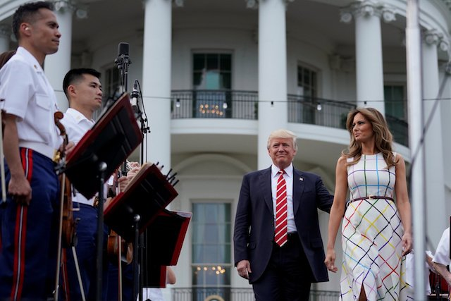 U.S. President Donald Trump and First Lady Melania Trump arrive to host a congressional picnic event for members of the congress and their families at the White House in Washington, U.S., June 22, 2017. REUTERS/Carlos Barria - RTS18A9K