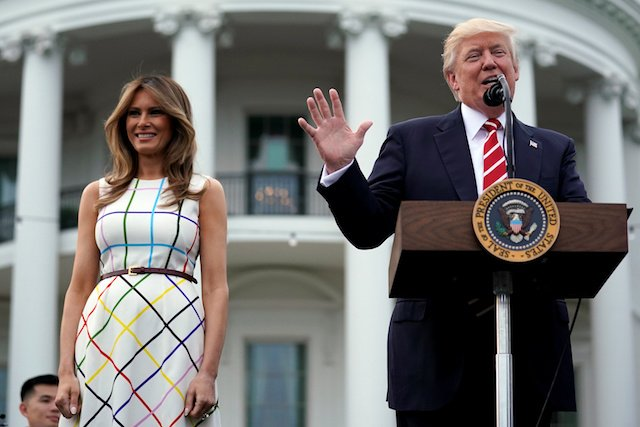 U.S. President Donald Trump delivers remarks as he hosts a Congressional picnic event, accompanied by First Lady Melania Trump, at the White House in Washington, U.S., June 22, 2017. REUTERS/Carlos Barria - RTS18AB2