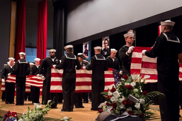Sailors ceremonially fold seven American flags during a memorial ceremony at Fleet Activities (FLEACT) Yokosuka for seven sailors assigned to Arleigh Burke-class guided-missile destroyer USS Fitzgerald (DDG 62) who were killed in a collision at sea on June 17, in Yokosuka, Japan in this photo taken and received June 27, 2017. Courtesy of U.S. Navy/Mass Communication Specialist 2nd Class Raymond D. Diaz III/Handout via REUTERS