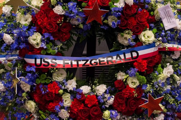 A bouquet of flowers in a memorial ceremony for seven sailors assigned to Arleigh Burke-class guided-missile destroyer USS Fitzgerald (DDG 62) who were killed in a collision at sea, June 17, is seen at Fleet Activities (FLEACT) Yokosuka in Yokosuka, Japan in this photo taken and received June 27, 2017. Courtesy of U.S. Navy/MC2(SW) Raymond D. Diaz III/Handout via REUTERS
