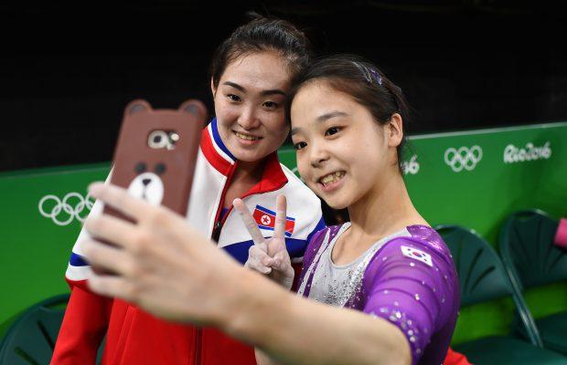 2016 Rio Olympics - Gymnastics training - Rio Olympic Arena - Rio de Janeiro, Brazil - 04/08/2016. Lee Eun-Ju (KOR) of South Korea (R) takes a selfie picture with Hong Un Jong (PRK) of North Korea. REUTERS/Dylan Martinez