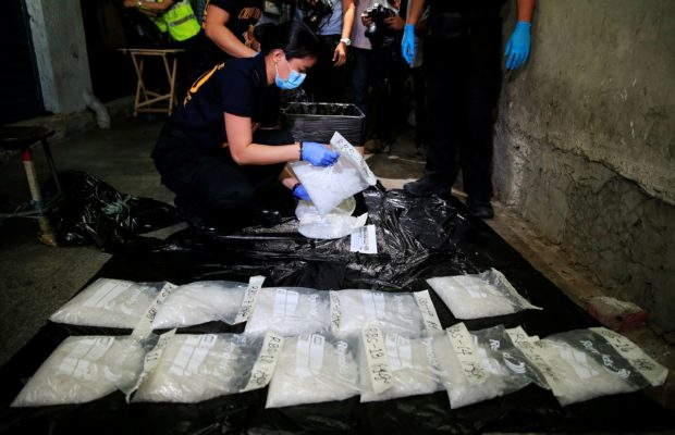 A police investigator makes an inventory of the Methamphetamine, locally known as Shabu, worth 120 million pesos ($2.41 million), that was confiscated during a drug-buy bust police operations in a mall at a Guadalupe city, metro Manila, Philippines November 21, 2016. REUTERS/Romeo Ranoco