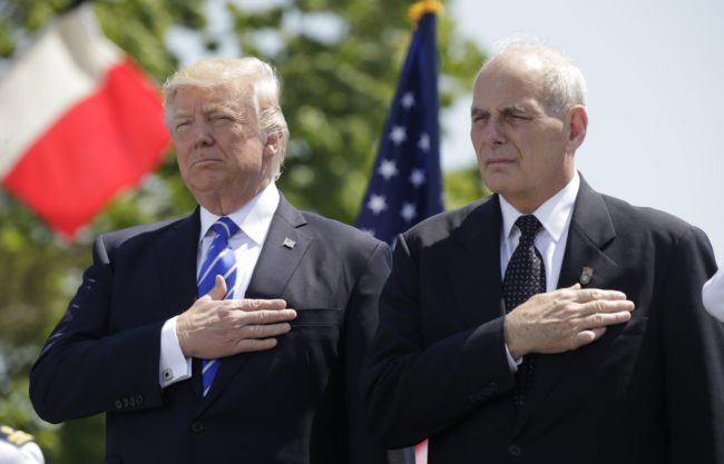 President Donald Trump and Department of Homeland Security Secretary John Kelly hold their hands over their hearts for the U.S. National Anthem as they attend the Coast Guard Academy commencement ceremonies in New London, Connecticut, May 17, 2017. REUTERS/Kevin Lamarque