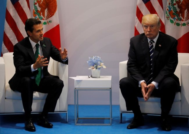 U.S. President Donald Trump speaks with Mexico's President Enrique Pena Nieto during their bilateral meeting at the G20 summit in Hamburg, Germany July 7, 2017. REUTERS/Carlos Barria