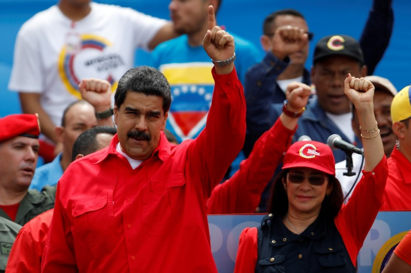 Venezuela's President Nicolas Maduro (L) gestures next to his wife Cilia Flores during the closing campaign ceremony for the upcoming Constituent Assembly election in Caracas, Venezuela, July 27, 2017. REUTERS/Carlos Garcia Rawlins