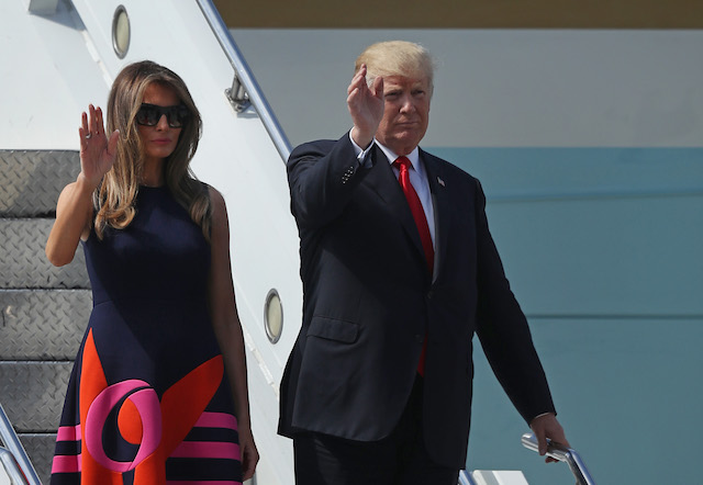 HAMBURG, GERMANY - JULY 06: U.S. President Donald Trump and First Lady Melania Trump wave as they arrive at Hamburg Airport for the Hamburg G20 economic summit on July 6, 2017 in Hamburg, Germany. Leaders of the G20 group of nations are meeting for the July 7-8 summit. Topics high on the agenda for the summit include climate policy and development programs for African economies. (Photo by Sean Gallup/Getty Images)