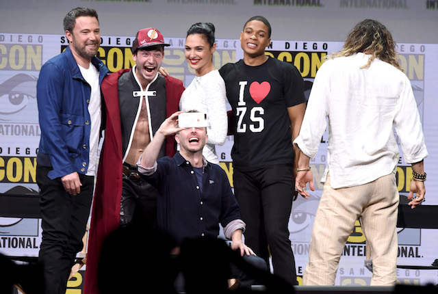 "SAN DIEGO, CA - JULY 22: (L-R) Actors Ben Affleck, Ezra Miller, Gal Gadot, Ray Fisher, and Jason Momoa from ""Justice League"" attend the Warner Bros. Pictures Presentation while moderator Chris Hardwick (bottom C) takes a selfie during Comic-Con International 2017 at San Diego Convention Center on July 22, 2017 in San Diego, California. (Photo by Kevin Winter/Getty Images)"
