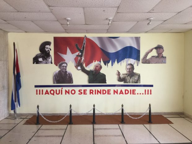 Leaders of the communist revolutuion are depicted on the wall at the Havana Ministry of Transportation. (Robert Donachie/ Daily Caller News Foundation)