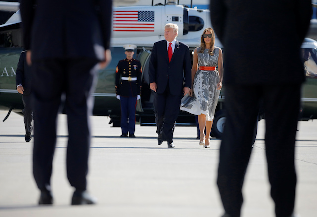 U.S. President Donald Trump and First Lady Melania Trump board Air Force One during their departure back to Washington, at Hamburg International Airport, in Hamburg, Germany, July 8, 2017. REUTERS/Carlos Barria - RTX3ANHU