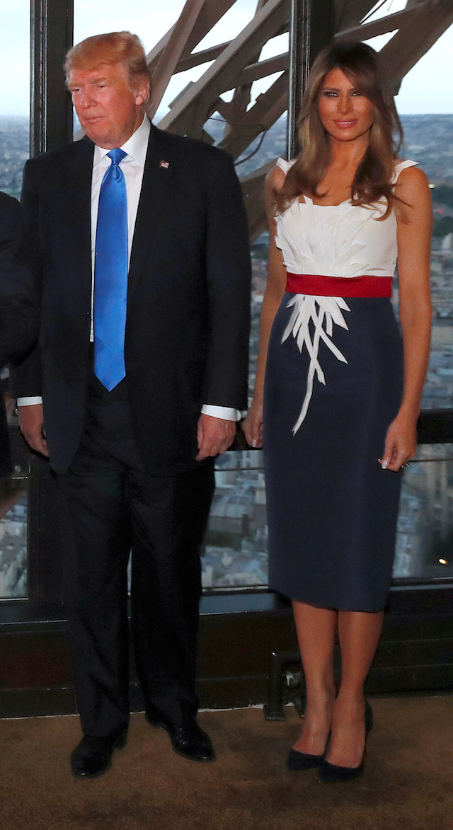 U.S. President Donald Trump and First lady Melania Trump pose at the Jules Verne restaurant before a private dinner at the Eiffel Tower in Paris, France, July 13, 2107. REUTERS/Yves Herman - RTX3BD67