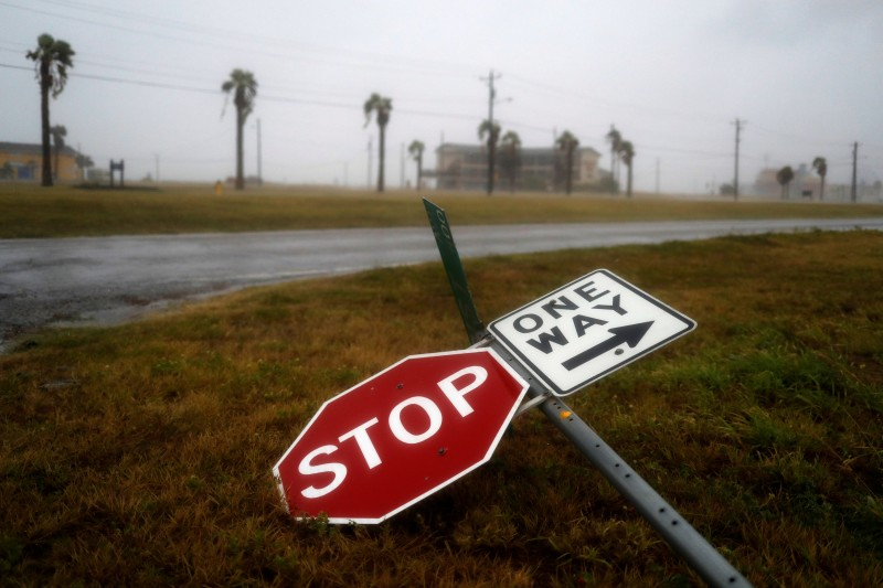 Street signs lie on the ground after winds from Hurricane Harvey escalated in Corpus Christi, Texas, U.S. August 25, 2017. REUTERS/Adrees Latif