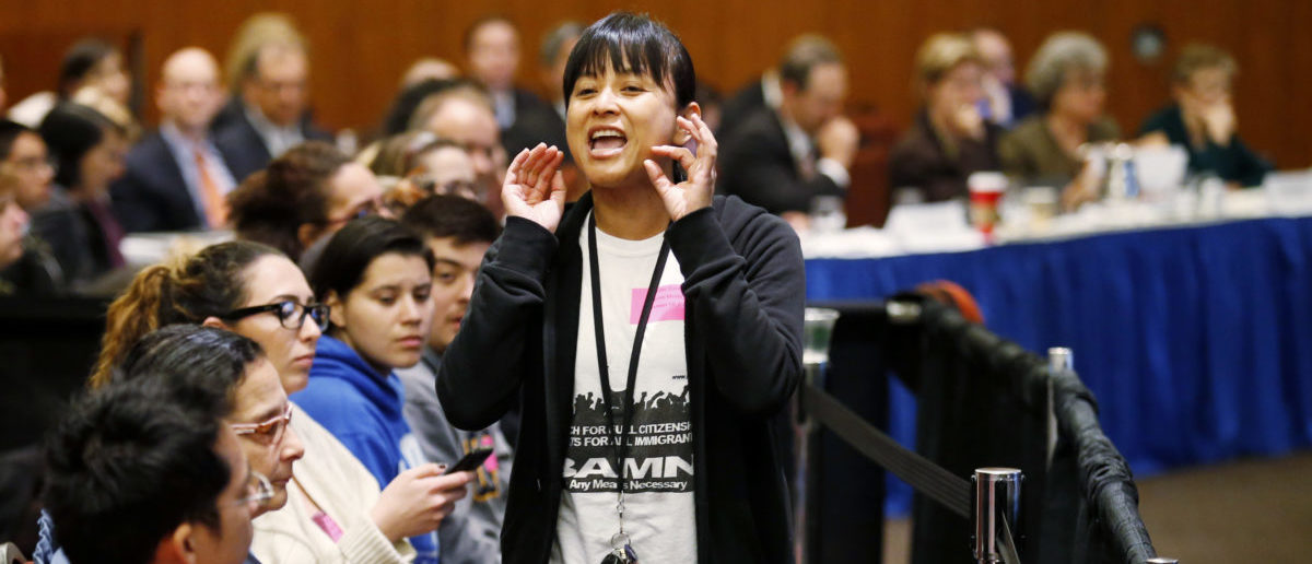 Yvette Felarca, from By Any Means Necessary, yells during the voting portion of a University of California Regents meeting, on a vote to raise tuition, at the University of California, San Francisco November 19, 2014. REUTERS/Beck Diefenbach