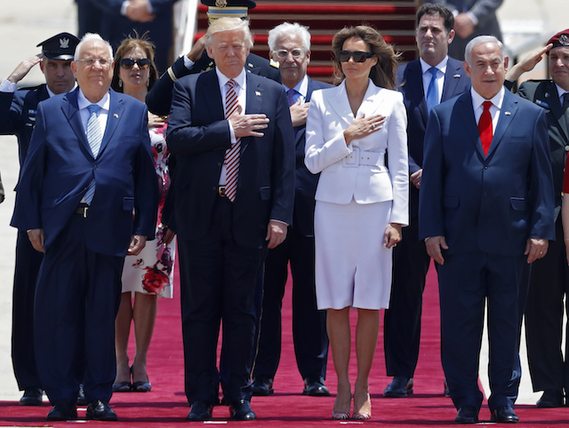 First Lady Melania Trump listens to the the national anthem as she and President Donald Trump are welcomed by Israeli Prime Minister Benjamin Netanyahu. / AFP PHOTO / Jack GUEZ (Photo credit should read JACK GUEZ/AFP/Getty Images)