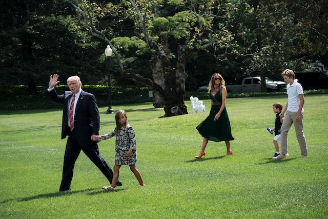 US President Donald Trump (C) walks with granddaughter Arabella Rose Kushner (L), US first lady Melania Trump (3L), Joseph Frederick Kushner (2R) and son Barron Trump to Marine One on the South Lawn of the White House on August 25, 2017 in Washington, DC. / AFP PHOTO / Brendan Smialowski (Photo credit should read BRENDAN SMIALOWSKI/AFP/Getty Images)
