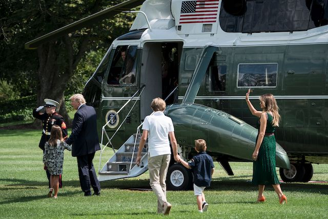 US President Donald Trump (3L) walks with granddaughter Arabella Rose Kushner (2L), son Barron Trump (3R) grandson Joseph Frederick Kushner (2R) and US first lady Melania Trump to Marine One on the South Lawn of the White House August 25, 2017 in Washington, DC. / AFP PHOTO / Brendan Smialowski (Photo credit should read BRENDAN SMIALOWSKI/AFP/Getty Images)
