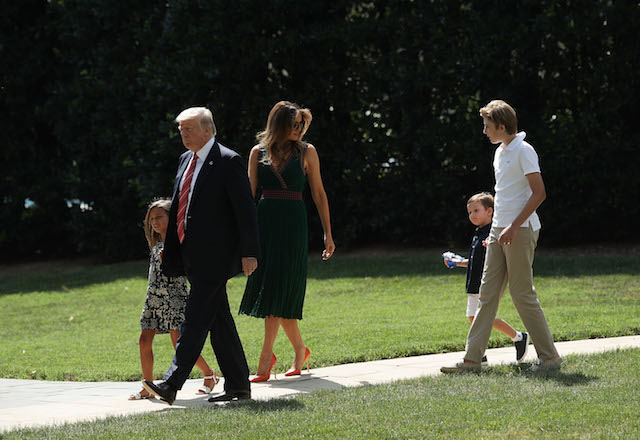 WASHINGTON, DC - AUGUST 25: U.S. President Donald Trump (2nd L) walks with first lady Melania Trump (3rd L), son Barron (R), granddaughter Arabella Rose Kushner (L) and grandson Joseph Frederick Kushner (4th L) towards the Marine One on the South Lawn of the White House prior to a departure August 25, 2017 in Washington, DC. President Trump is spending the weekend with his family at Camp David. (Photo by Alex Wong/Getty Images)