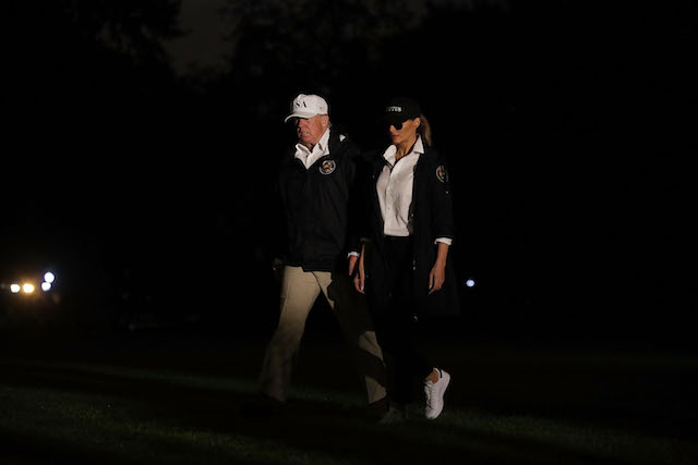 bc0affd48f0b President Donald Trump and first lady Melania Trump walk on the South Lawn  after they returned