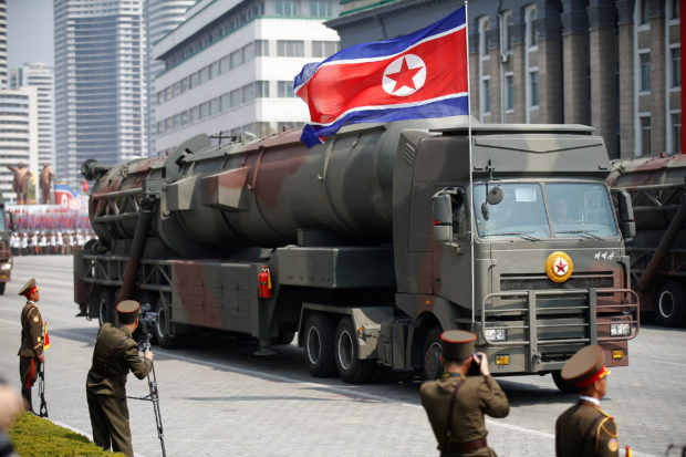 Missiles are driven past the stand with North Korean leader Kim Jong Un and other high ranking officials during a military parade marking the 105th birth anniversary of country's founding father, Kim Il Sung, in Pyongyang April 15, 2017. REUTERS/Damir Sagolj