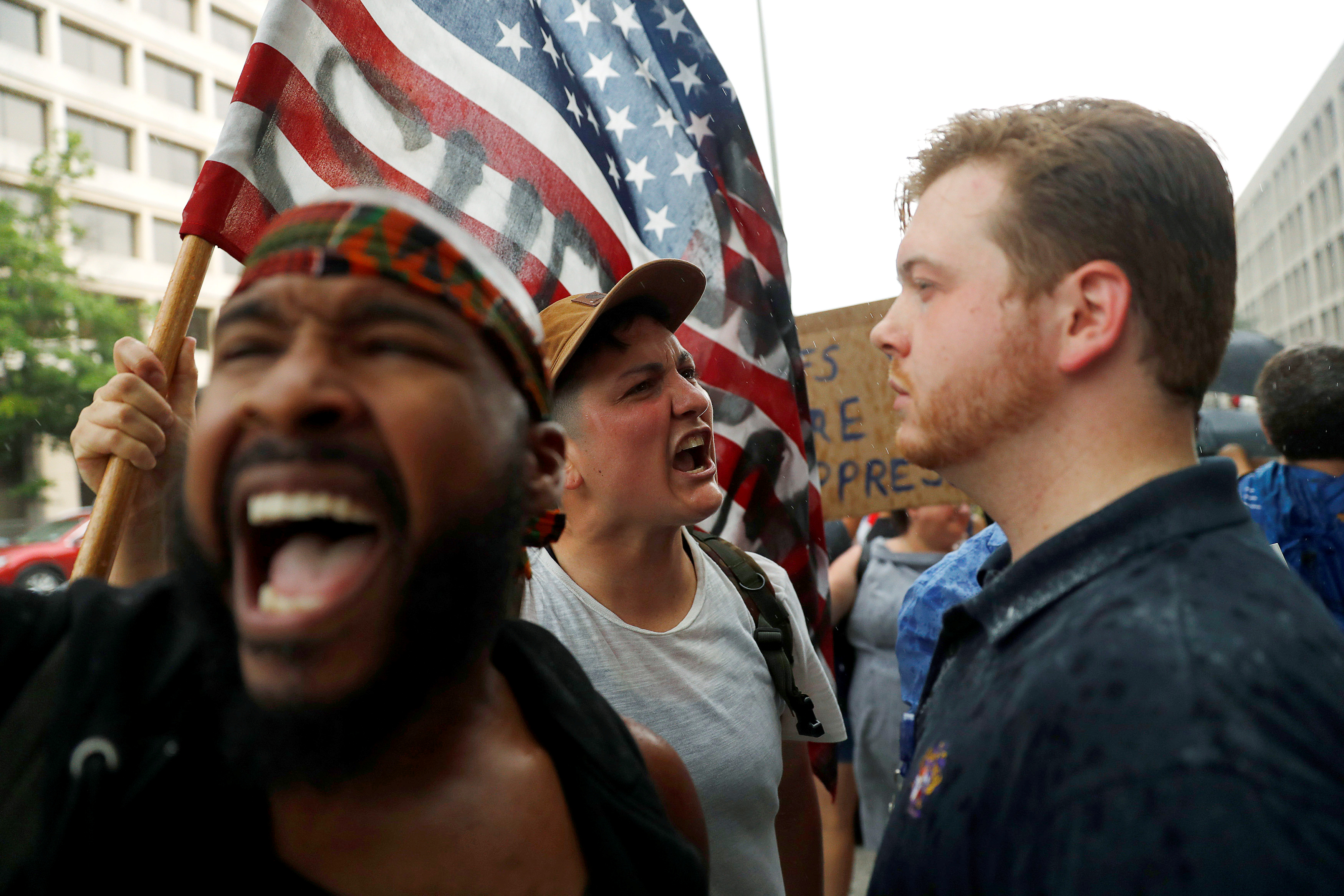 Demonstrators confront reporters with The Daily Caller News Foundation during a protest calling for the removal of the statue of Confederate General Albert Pike in Washington, U.S., August 18, 2017. REUTERS/Aaron P. Bernstein