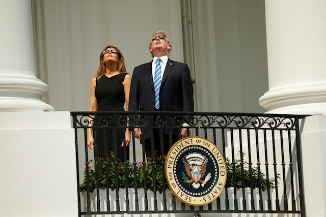 U.S. President Donald Trump watches the solar eclipse with first Lady Melania Trump from the Truman Balcony at the White House in Washington, U.S., August 21, 2017. REUTERS/Kevin Lamarque - RTS1CPB7