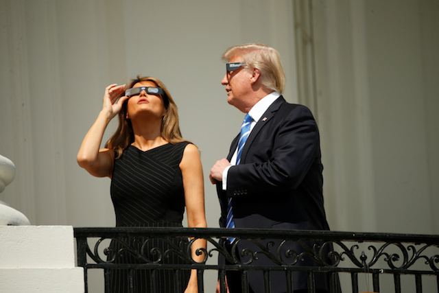 U.S. President Donald Trump watches the solar eclipse with first Lady Melania Trump from the Truman Balcony at the White House in Washington, U.S., August 21, 2017. REUTERS/Kevin Lamarque - RTS1CPC5