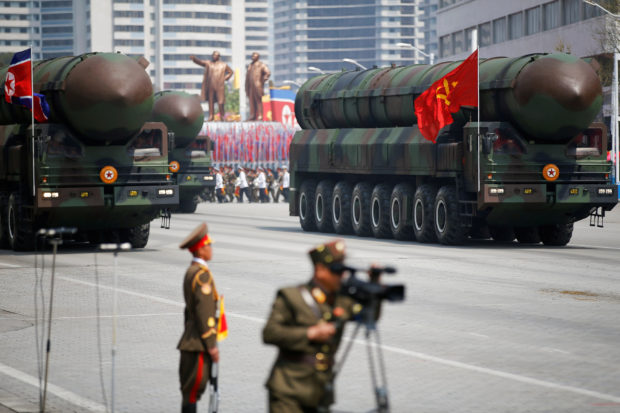 Intercontinental ballistic missiles (ICBM) are driven past the stand with North Korean leader Kim Jong Un and other high ranking officials during a military parade marking the 105th birth anniversary of country's founding father Kim Il Sung, in Pyongyang April 15, 2017. The missiles themselves were shown for the first time inside a new kind of canister-based launcher on Saturday. The trucks upon which they are mounted are originally designed to move lumber. REUTERS/Damir Sagolj/File Photo