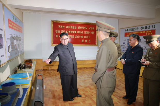 North Korean leader Kim Jong-Un gives field guidance during a visit to the Chemical Material Institute of the Academy of Defense Science in this undated photo released by North Korea's Korean Central News Agency (KCNA) in Pyongyang on August 23, 2017. KCNA/via REUTERS