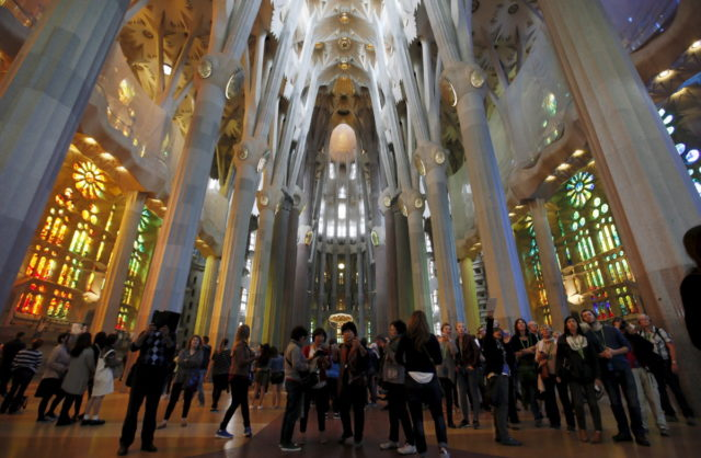 People visit the Basilica Sagrada Familia, which was designed by Antoni Gaudi, in Barcelona, Spain, October 21, 2015. REUTERS/Albert Gea - RTS5JIA