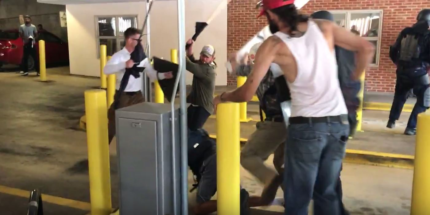 Video shows white supremacists beating a young African American man senselessly. (Brenton Roy/TheDCNF)