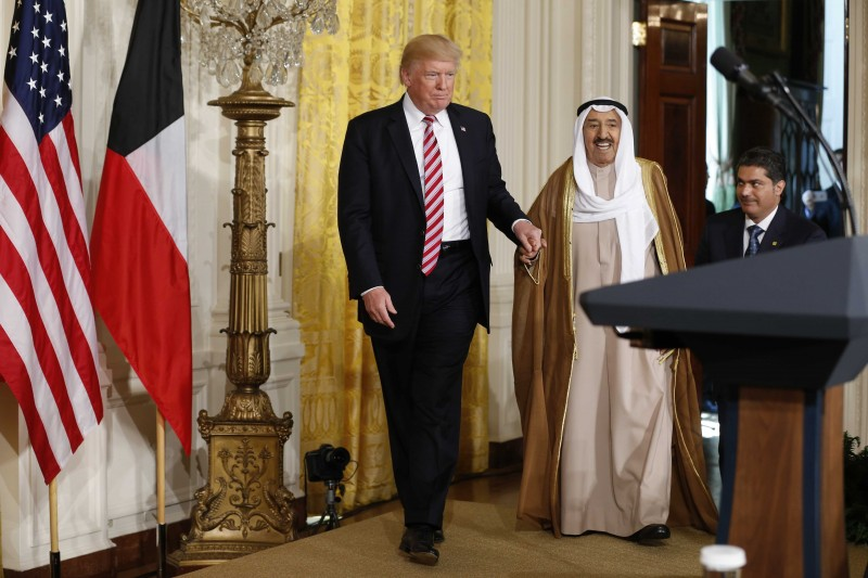 U.S. President Donald Trump (L) arrives for a joint news conference with Emir of Kuwait Sabah Al-Ahmad Al-Jaber Al-Sabah (C) in the East Room of the White House in Washington, U.S., September 7, 2017. REUTERS/Jonathan Ernst