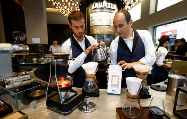 """A barman prepares Lavazza """"slow coffee"""" blend during the new opening of Lavazza's flagship coffee store in Milan, Italy, September 19, 2017. REUTERS/Stefano Rellandini"""