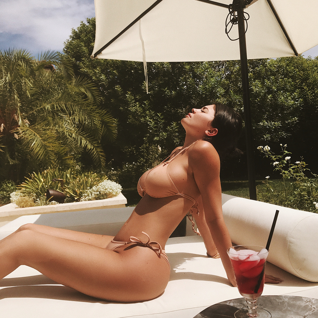 Kylie Jenner basks in the sunlight in a itty bitty bikini. (photo: Instagram)
