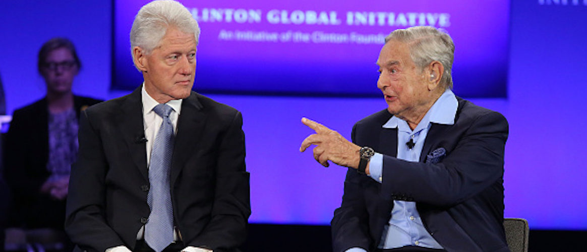 NEW YORK, NY - SEPTEMBER 27: President Bill Clinton and George Soros speak during the 2015 Clinton Global Initiative Annual Meeting at Sheraton Times Square on September 27, 2015 in New York City. (Photo by Taylor Hill/FilmMagic)