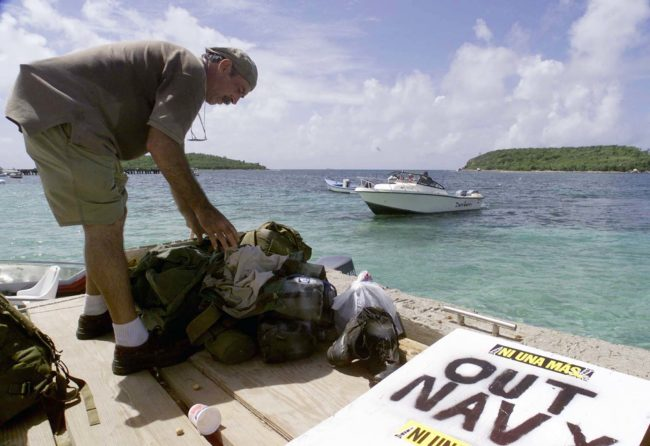 An anti navy man prepares to board a fishing boat in Esperanza bay in Vieques, Puerto Rico, August 4, 2001 in their attempt to halt the second day of the US Navy bombing training exercises. (Photo: REUTERS)