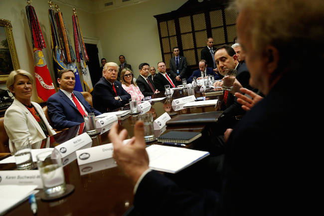 President Donald Trump meets with members of the National Association of Manufacturers, including ACE Clearwater Enterprises President Kellie Johnson (L-R), National Association of Manufacturers CEO Jay Timmons, Matrix 4 CEO Patricia Miller, Apache Stainless Equipment President Ed Paradowski and Staub Manufacturing Solutions President Steve Staub, at the White House in Washington, March 31, 2017. REUTERS/Jonathan Ernst