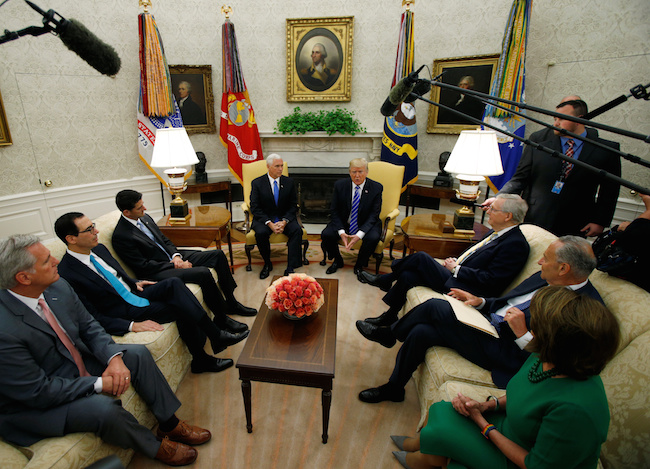 President Donald Trump meets with congressional leaders: House Majority Leader Rep. Kevin McCarthy, Treasury Secretary Steve Mnuchin, Speaker of the House Paul Ryan, Vice President Mike Pence, Senate Majority Leader Mitch McConnell, Senate Minority Leader Chuck Schumer and House Minority Leader Nancy Pelosi in the Oval Office of the White House in Washington, September 6, 2017. REUTERS/Kevin Lamarque