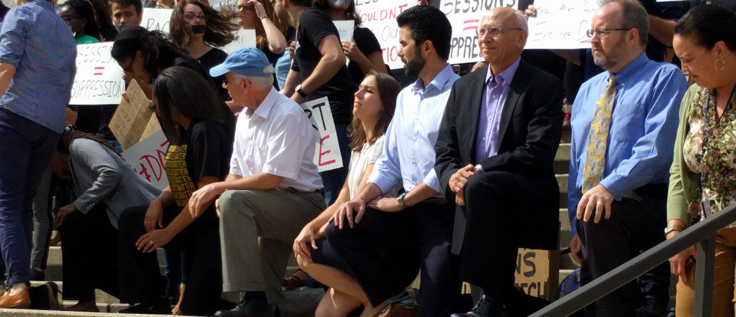 Georgetown faculty members kneel in protest of a speech by Attorney General Jeff Sessions at the Georgetown University Law School on Sept. 26, 2017. (Will Racke/TheDCNF)