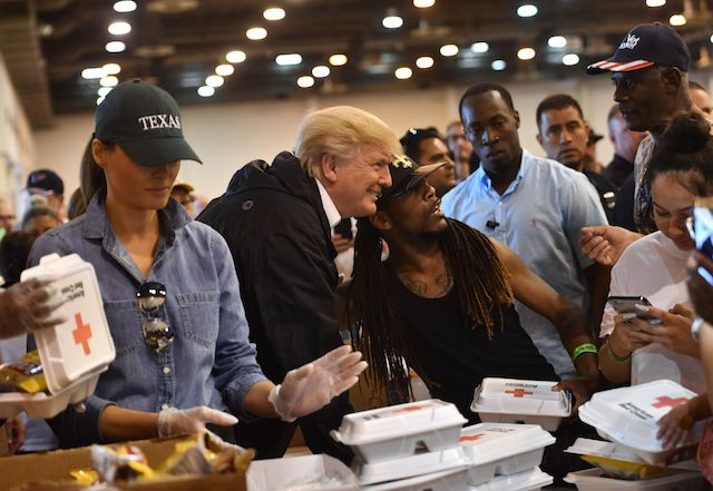 US President Donald Trump and First Lady Melania Trump serve food to Hurricane Harvey victims at NRG Center in Houston on September 2, 2017. / AFP PHOTO / Nicholas Kamm (Photo credit should read NICHOLAS KAMM/AFP/Getty Images)