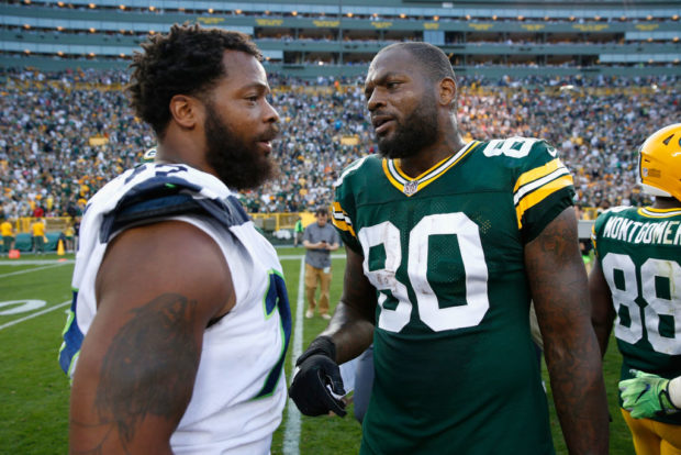 GREEN BAY, WI - SEPTEMBER 10: Michael Bennett #72 of the Seattle Seahawks talks with brother Martellus Bennett #80 of the Green Bay Packers after the Packers defeated the Seahawks 17-9 at Lambeau Field on September 10, 2017 in Green Bay, Wisconsin. (Photo by Joe Robbins/Getty Images)