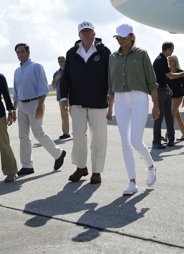 US President Donald Trump and First Lady Melania Trump, with US Senator Marco Rubio (L), arrive in Fort Myers, Florida, on September 14, 2017. Trump visits areas affected by Hurricane Irma. / AFP PHOTO / Brendan Smialowski (Photo credit should read BRENDAN SMIALOWSKI/AFP/Getty Images)