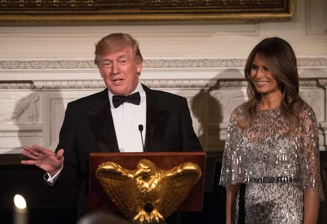 US President Donald Trump speaks alongside First Lady Melania Trump as they host the White House Historical Association dinner at the White House in Washington, DC, on September 14, 2017. / AFP PHOTO / NICHOLAS KAMM (Photo credit should read NICHOLAS KAMM/AFP/Getty Images)