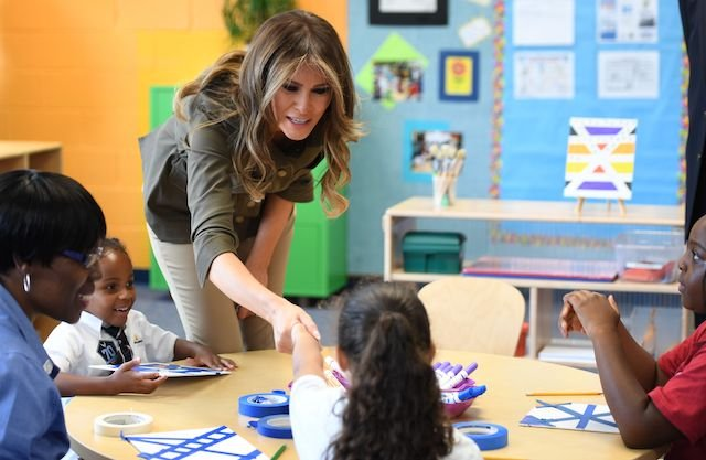 US First Lady Melania Trump shakes hands with a student as she visits a youth centre at Joint Andrews Airforce base, Maryland on September 15, 2017. / AFP PHOTO / JIM WATSON (Photo credit should read JIM WATSON/AFP/Getty Images)