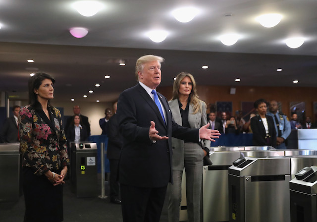 NEW YORK, NY - SEPTEMBER 19: U.S. President Donald Trump stands with U.S. Ambassador to the United Nations Nikki Haley (L) and first lady Melania Trump upon arrival to the UN headquarters on September 19, 2017 in New York City. He addressed world leaders for the first time at the annual UN General Assembly meeting. (Photo by John Moore/Getty Images)