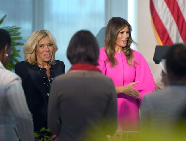 US First Lady Melania Trump (R) and Frence First Lady Brigitte Macron greet guests at a United Nations luncheon for first spouses of world leaders on September 20, 2017, at the United States Mission to the UN in New York. The US First Lady addressed the issue of vulnerable children around the world. / AFP PHOTO / DON EMMERT (Photo credit should read DON EMMERT/AFP/Getty Images)