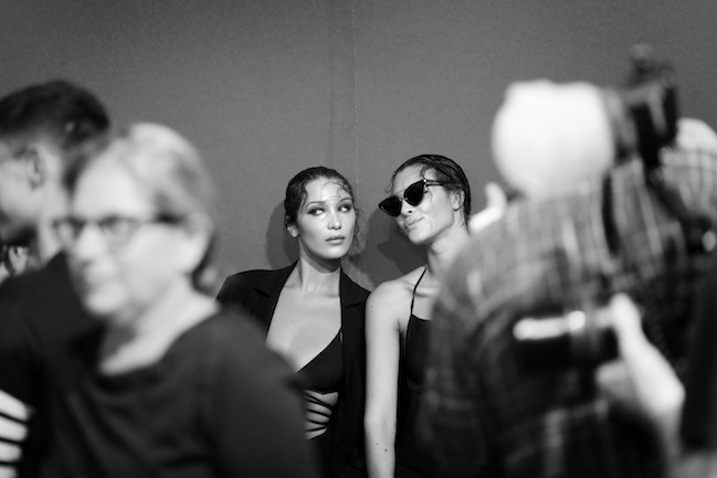 MILAN, ITALY - SEPTEMBER 20: (EDITORS NOTE: Image has been converted to black and white.)Bella Hadid and Martha Hunt is seen backstage ahead of the Alberta Ferretti show during Milan Fashion Week Spring/Summer 2018 on September 20, 2017 in Milan, Italy. (Photo by Tristan Fewings/Getty Images)
