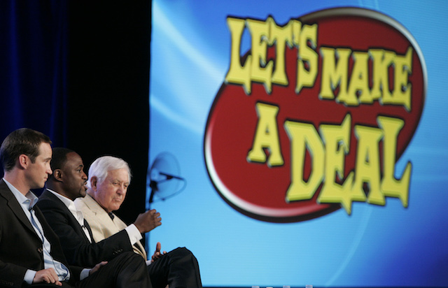 """Executive producer Mike Richards (L) and creative consultant Monty Hall of """"Let's Make A Deal"""" to daytime listen as host Wayne Brady (C) speaks during a panel disucssion at the CBS Summer 2009 Television Critics Association press tour in Pasadena, California August 3, 2009. REUTERS/Fred Prouser"""