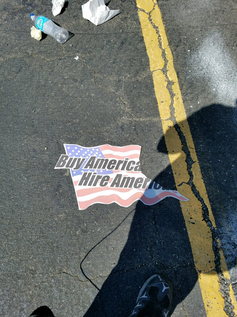 Anti-Trump activists rip up American flags with pro-American message. Photo courtesy of Rob Cortis