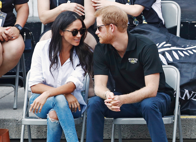 Britain's Prince Harry (R) arrives with girlfriend actress Meghan Markle at the wheelchair tennis event during the Invictus Games in Toronto, Ontario, Canada September 25, 2017. REUTERS/Mark Blinch -