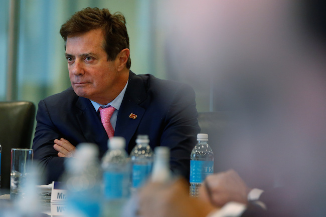 Paul Manafort of Donald Trump's staff listens during a round table discussion on security at Trump Tower in the Manhattan borough of New York, August 17, 2016. REUTERS/Carlo Allegri