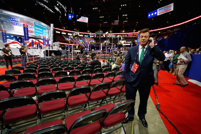 FILE -- Paul Manafort, campaign manager to Donald Trump, talks on the phone from the floor of the Republican National Convention in Cleveland, July 17, 2016. REUTERS/Rick Wilking
